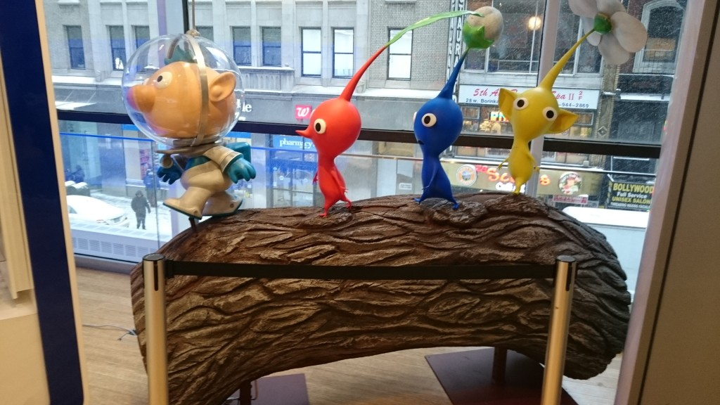 Pikmin statue to the right of the History and Smash Bros display